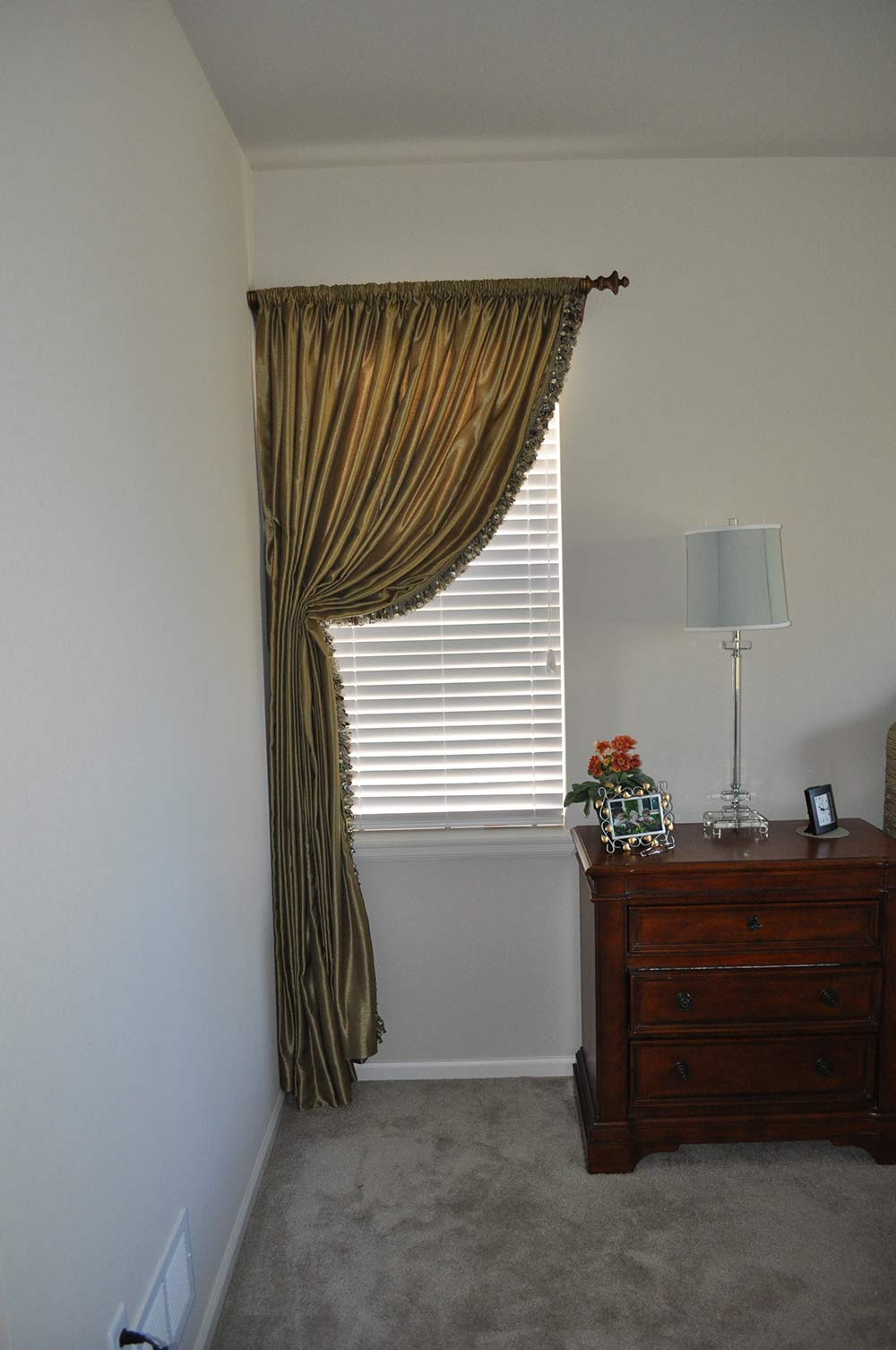 curtain with fringe pulled to one side