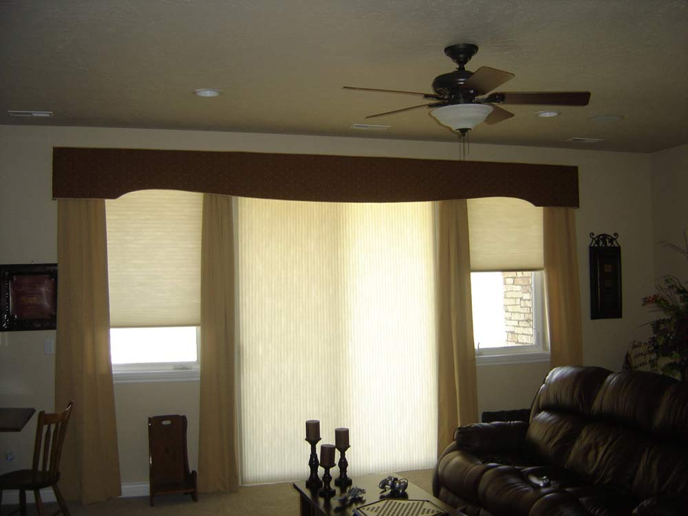 large windows covered in window valence and shades