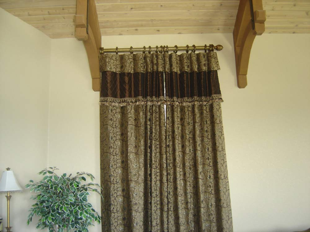 gold half curtain rod with traditional curtains
