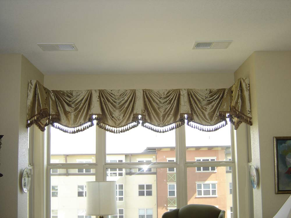 windows with gold valence
