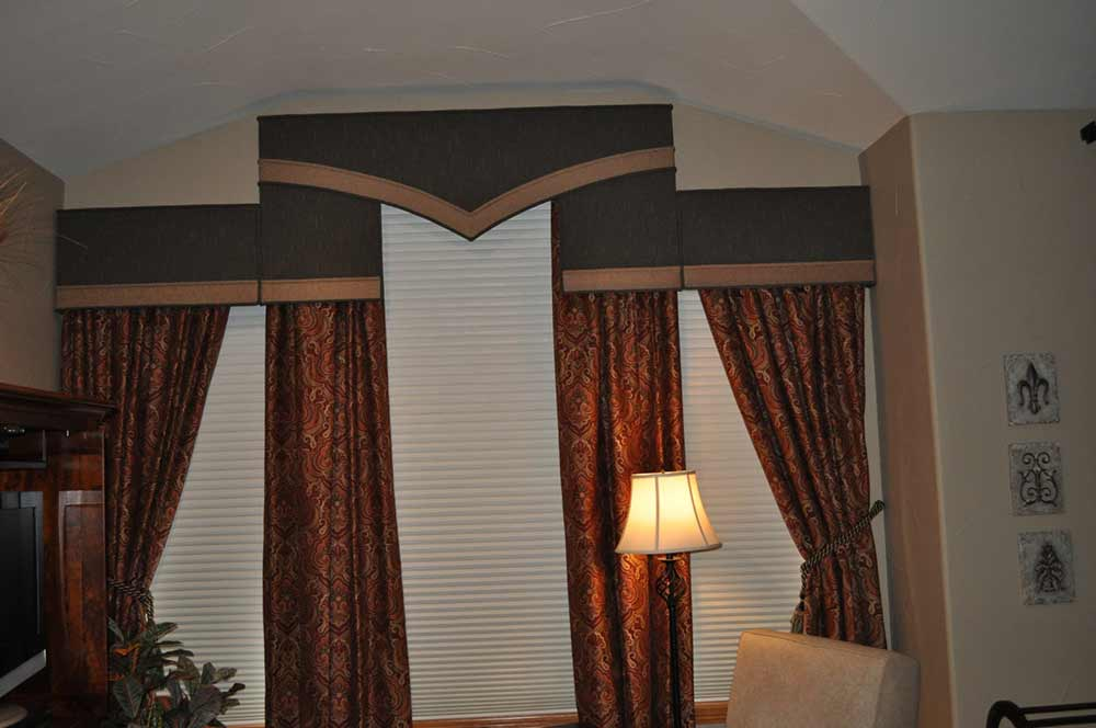 brocade pattern curtains tied back with decorate ties