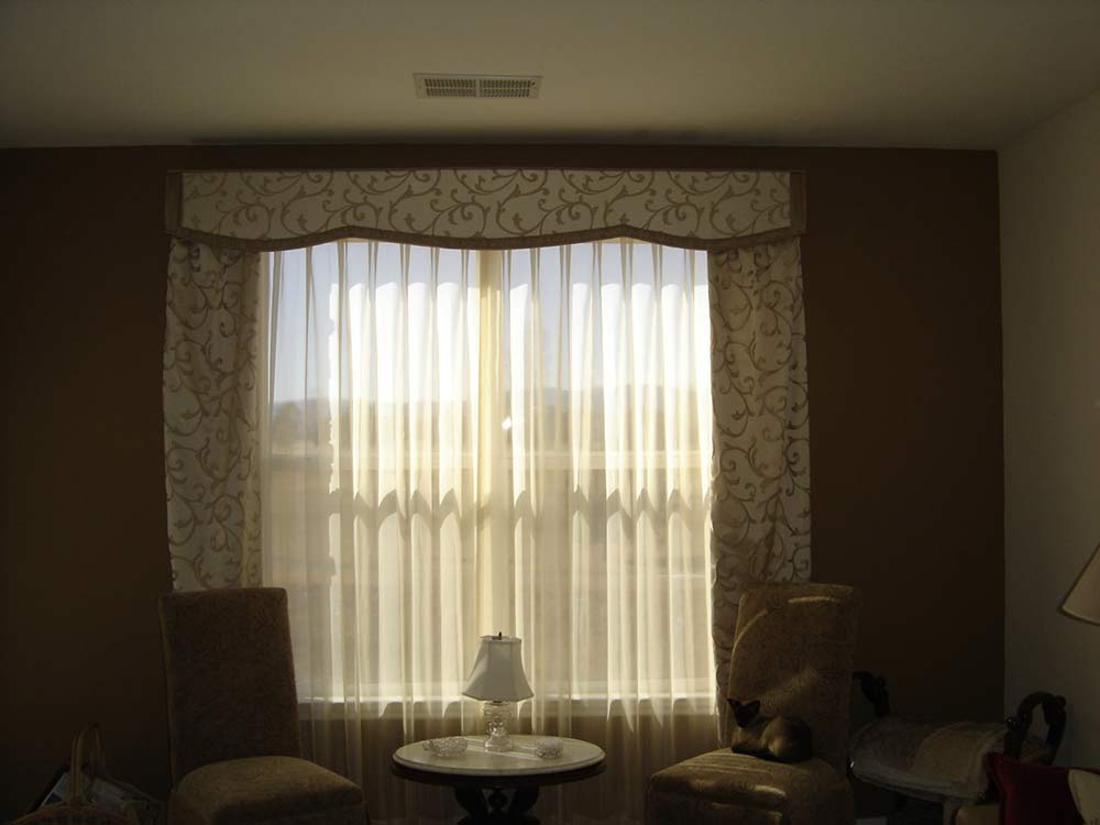 matching window drapes and valence in gold filigree pattern