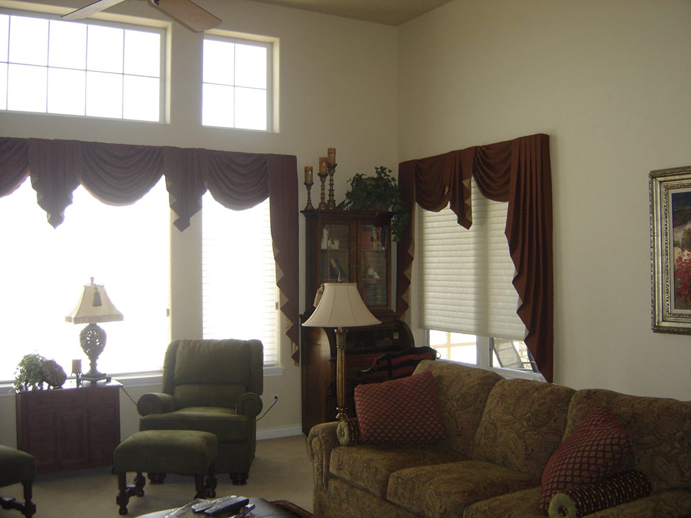 living room with classic furniture and maroon accents including drapery