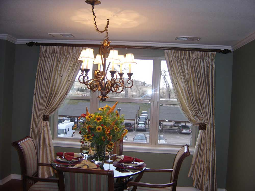 curtains pulled back and tucked behind decorative knobs