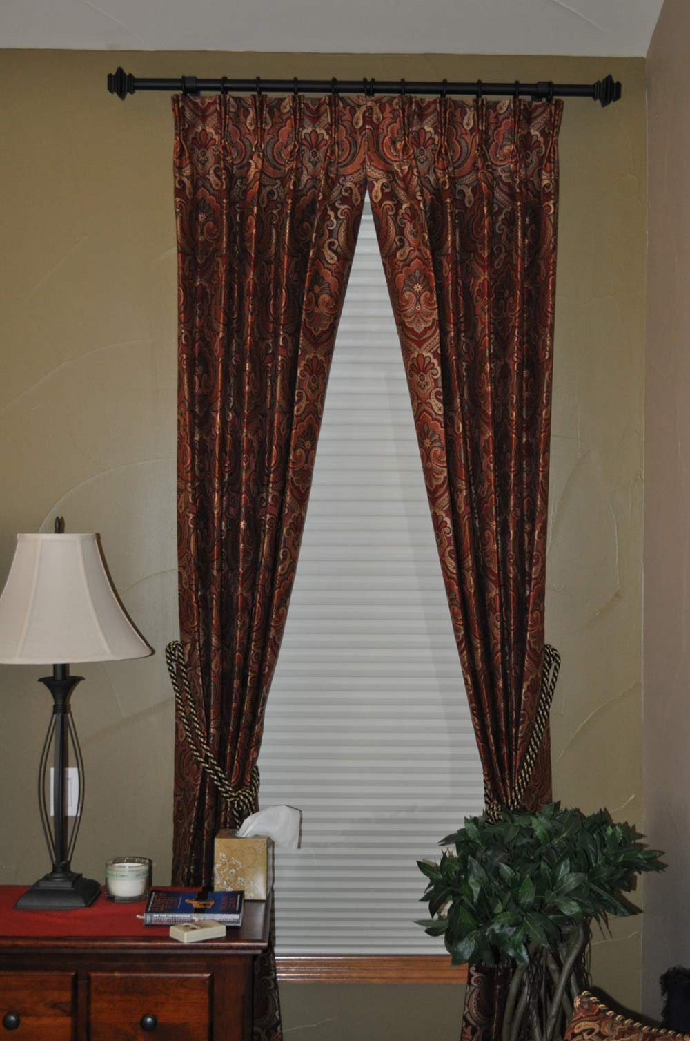 bold curtains tied back with decorative ropes