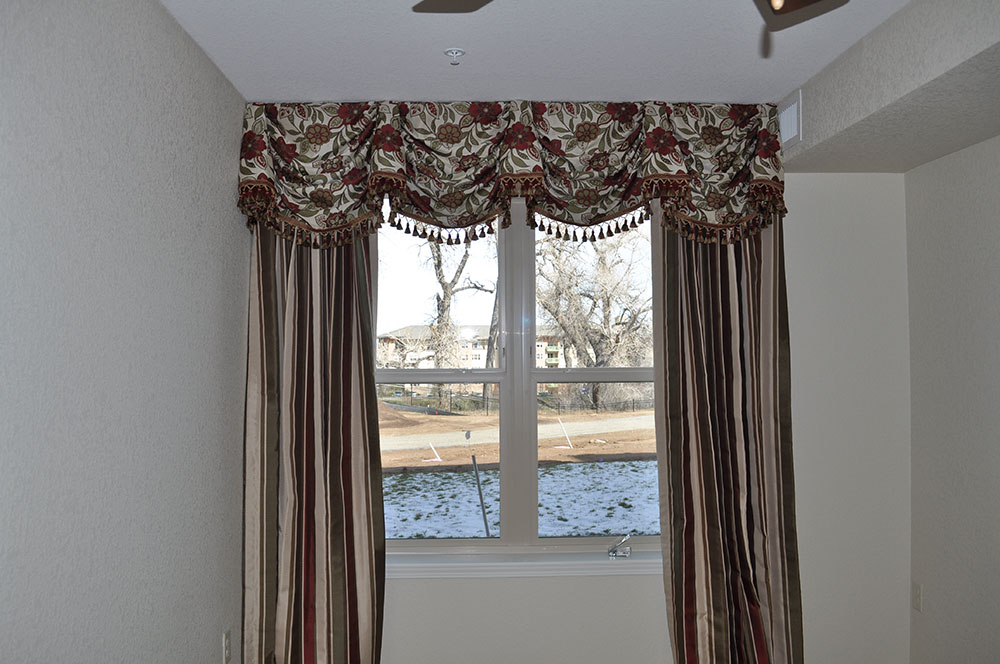 red and green floral curtains and valence