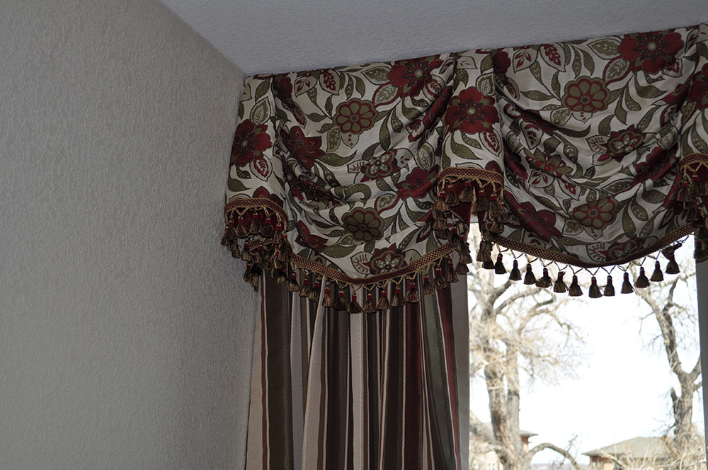 close-up of red and green floral curtains and valence
