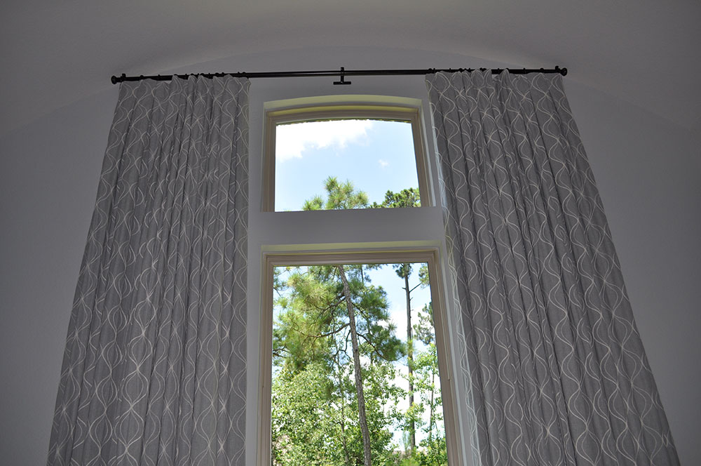 floor-to-ceiling light grey curtains