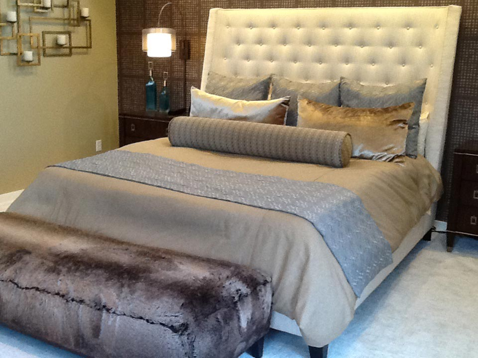 large bed with grey and tan blankets