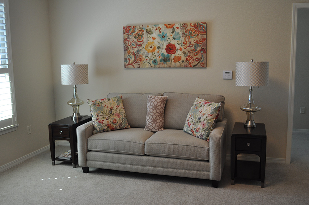 living room with floral pattern accents