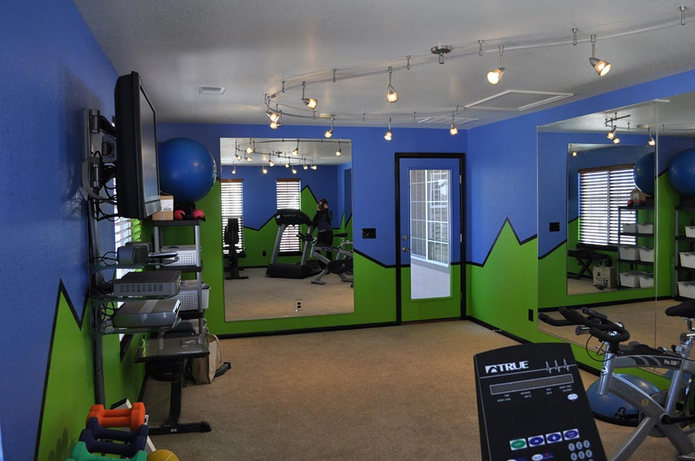 new home gym with graphic blue and green walls