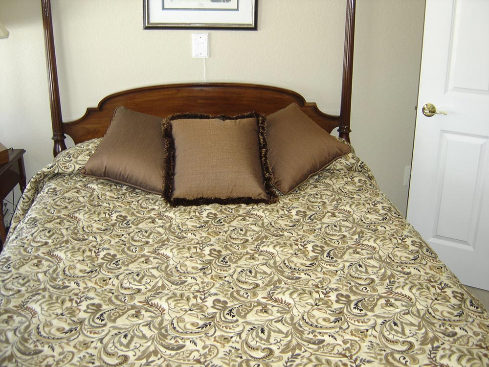 brocade pattern comforter in spare bedroom