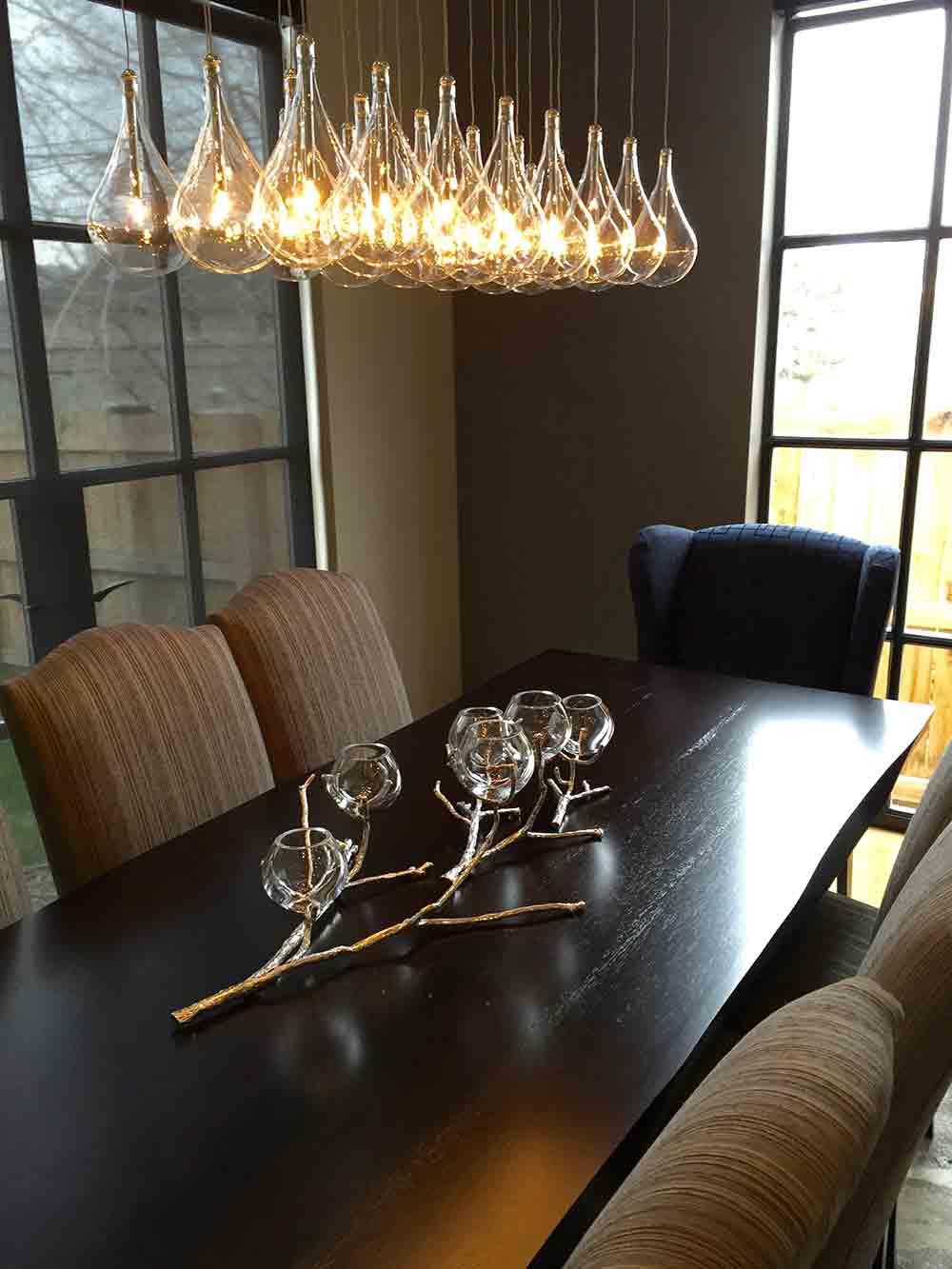 modern light fixture centered above dining table