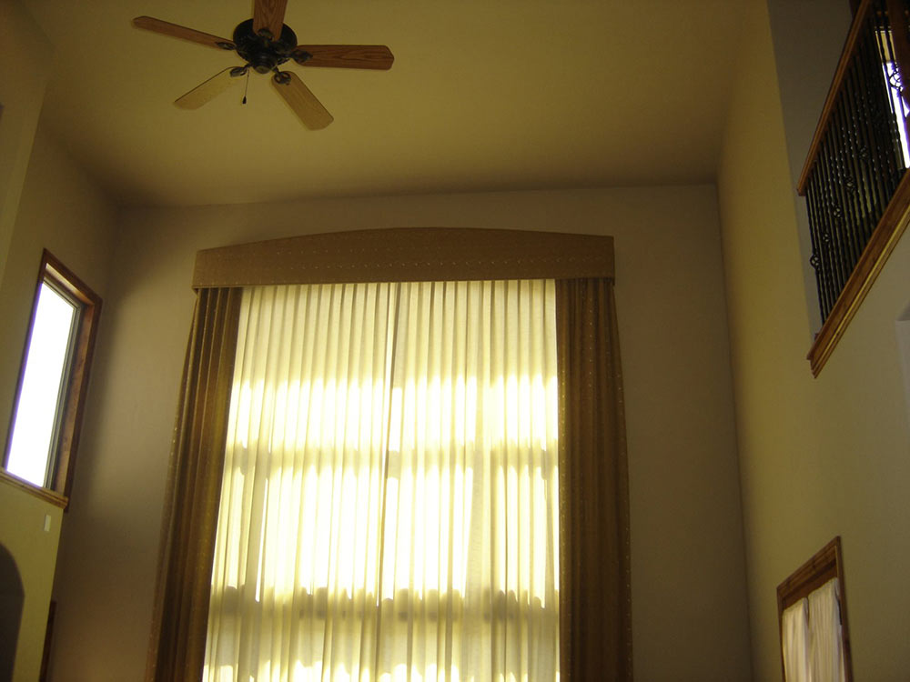 floor-to-ceiling curtains over two-story windows