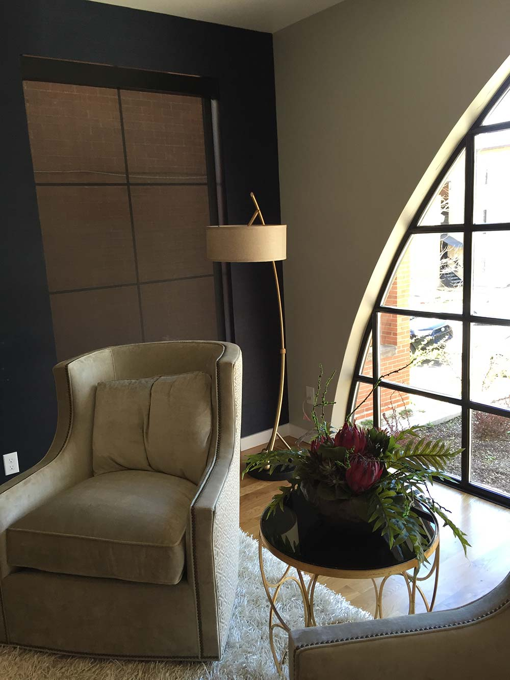 accent chair, table and lamp in a corner of living room