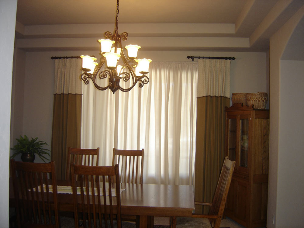 traditional dining room with golden curtains over windows