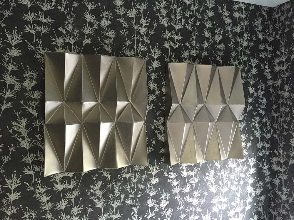 metal decorative panels on floral wall