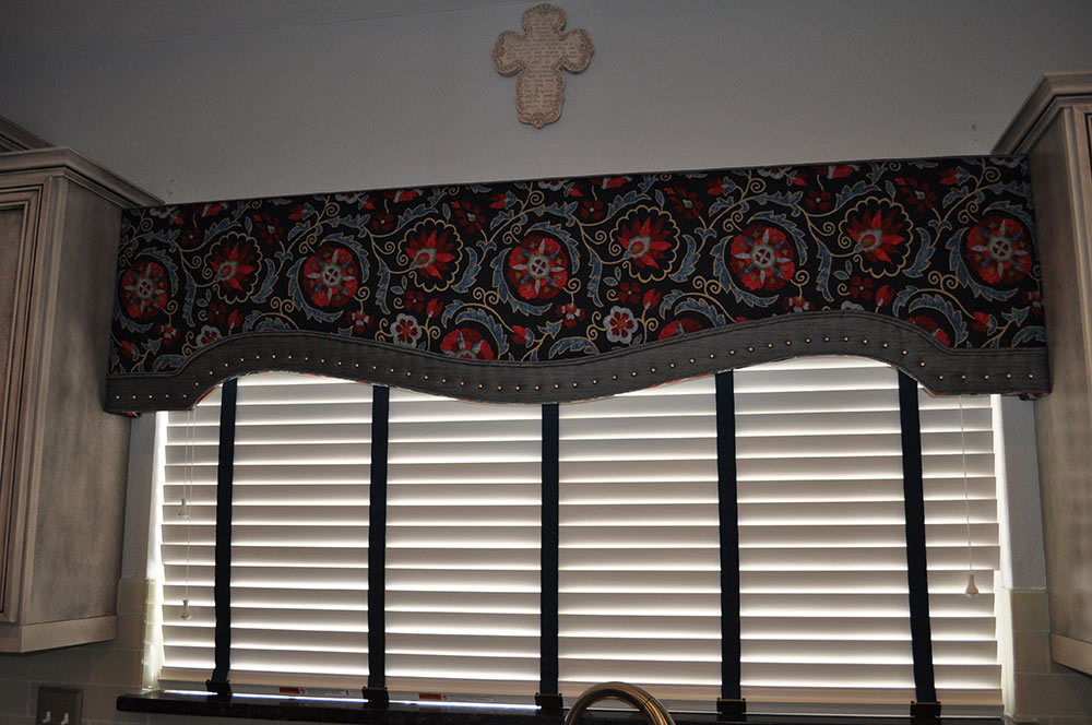 blinds with navy and red drapery and stud details