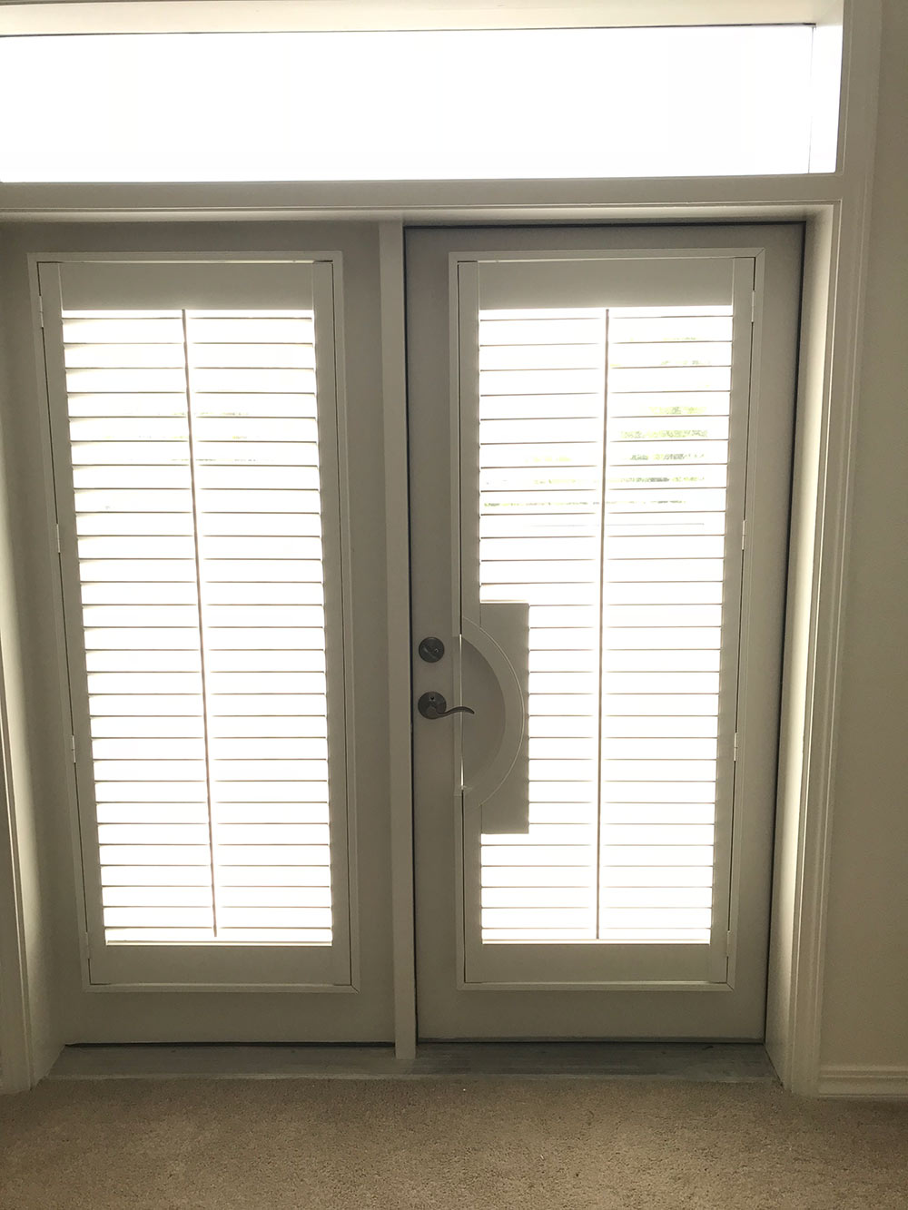 slatted window coverings on french doors
